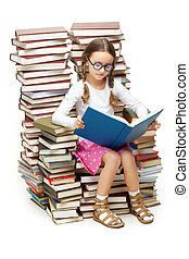 Girl reading - Portrait of diligent pupil sitting on pile of...