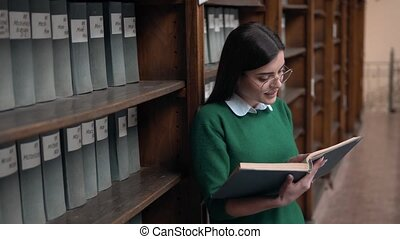 Girl Readng the Book in Library