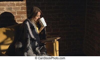 Girl Reads Book While Having Tea