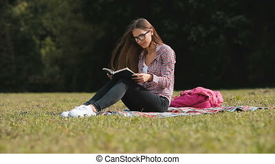 Girl Reads in Park