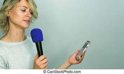 Girl reads text in microphone