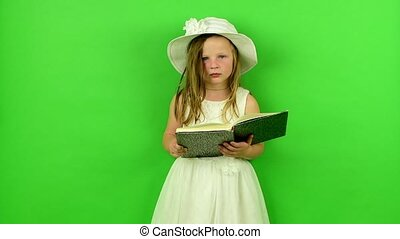 Girl reads the book. Small girl on chroma key background. -...