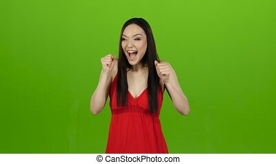 Girl received a big win, she is happy with her victory. Green screen