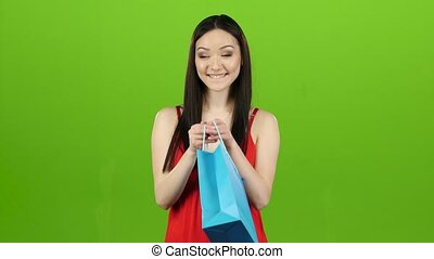 Girl received a gift, opens it and rejoices. Green screen