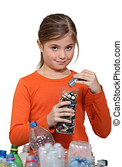 Girl recycling batteries