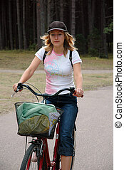 Girl relax biking in the forest