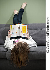Girl relaxing and reading