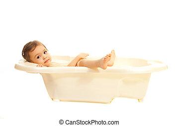 Girl relaxing in a bathtub