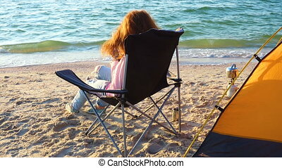 Girl relaxing in a chair