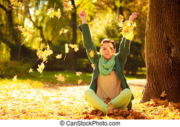 girl relaxing in colorful forest foliage outdoor. - ...