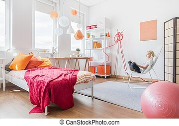 Girl relaxing in her bedroom