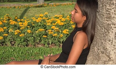 Girl Relaxing In Park