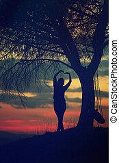 Girl relaxing in sunset