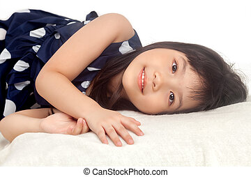 Girl relaxing on bed with smile