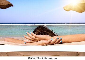 Girl relaxing in the blue beach of Marsa Alam