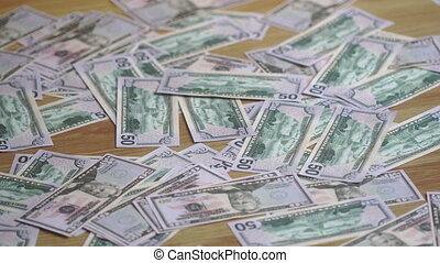 girl removes money from the floor