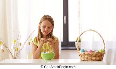 girl removing wrapper of chocolate easter egg - easter,...