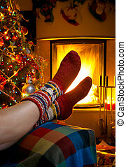 girl resting in room with fireplace Christmas