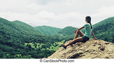 Girl resting in the mountains