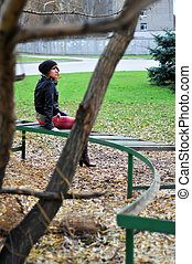 Girl resting on a bench 2
