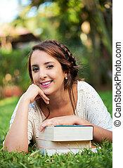girl resting on books