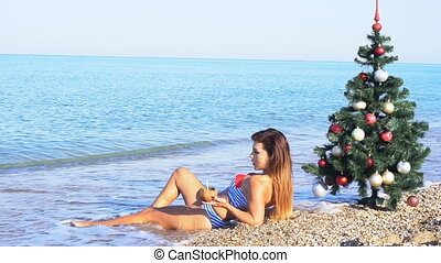 girl resting on the beach in the resort of Christmas new...