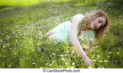 Girl resting on the nature. Beautiful girl lying on the field.