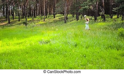 Girl resting on the nature. Beautiful girl walk on the field.