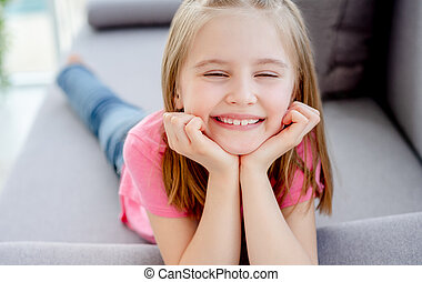 Girl resting with head on hands