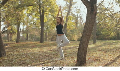 Girl retains a sense of balance and equilibrium in the park...