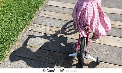 Girl ride a bicycle