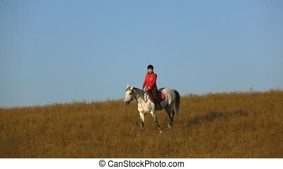 Girl rider riding a horse. Slow motion - Cute attractive...