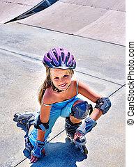 Girl rides on roller skates.