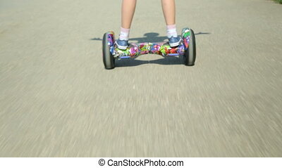 Girl riding a gyroscooter