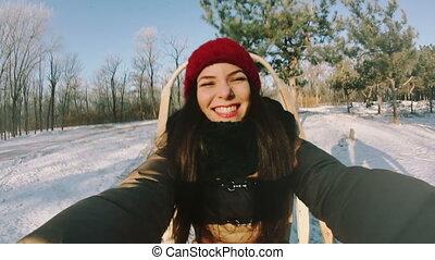 Girl riding a sleigh