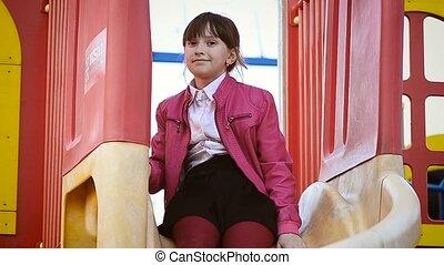 Girl riding a slide