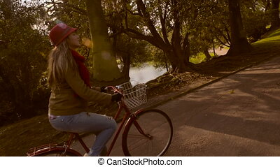 Girl riding bike at the park on fall slow motion - Girl...
