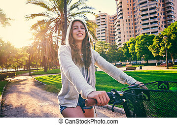 girl riding bike in the park hoodie sweater