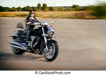 Girl riding on a motorcycle