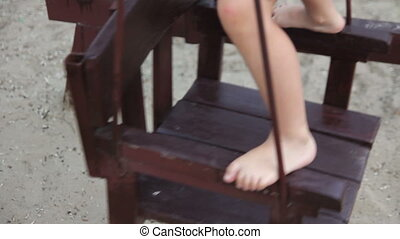 Girl riding on a swing