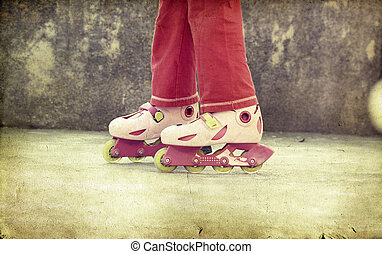 girl riding on roller skates