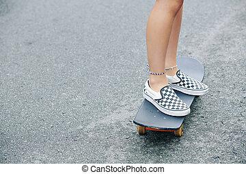 Girl riding on skateboard