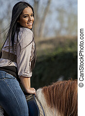 Girl riding on the horse