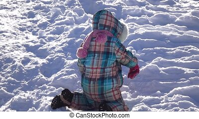 Girl riding on the snowy slope - In the winter park girl...