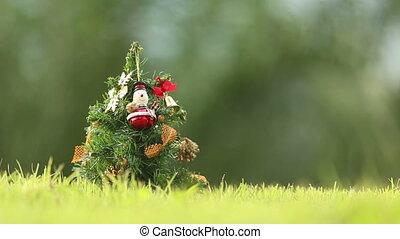 girl rings a bell neer the Christmas tree