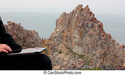 Girl. Rock Shamanka, headland Burhan, Olkhon island, Baikal,...