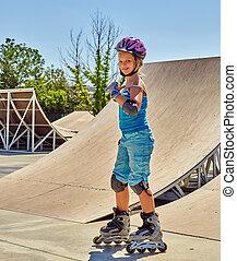Girl roller skate helmet walking park. Child riding on roller skates.