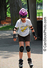 Girl rollerblading - Young girl rollerblading in a summer...