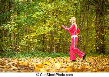 Girl runing jogging autumnal park