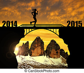Girl running across the bridge to the New Year 2015. In the...